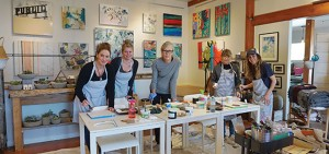 The Kube Studios owner Christa Joe, second from left, poses with participants at a Monday morning painting workshop, including instructor/artist Jill Pilon at the far right. Anna Nobile photo