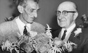 "June 26, 1968 -- ""Sechelt Garden Club president Mr. Frank Read and Retired Garden Man, Mr. Tom Barber admire the beautiful flame roses and white spirea table decoration which won the Garden Club's special prize in the Spring Show. Mr. Barber who is now 74 years old, wrote a 600 word column for the Vancouver Sun. Now retired he has spent the last nine years testing seeds for All America Selections, doing all the work himself. """