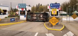 Car flips into ferry booths